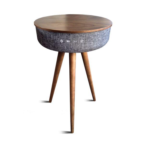 Table en bois avec enceinte compatible et sa batterie externe intégrée
