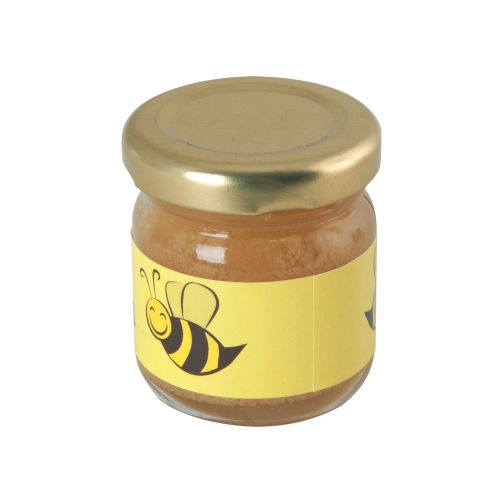 Petit pot en verre avec miel de fleurs
